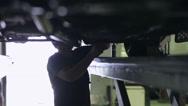 Worker repairs car Stock Footage
