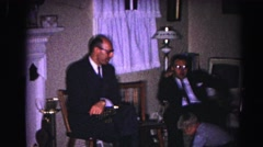 1962: family holiday event kids playing while adult men chat in chairs Stock Footage