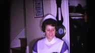 1962: nurse playfully helps boy put away his hat HAGERSTOWN, MARYLAND Stock Footage