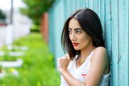 Girl brunette in a park in the summer resting white blouse on the background of Stock Photos