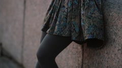 Close-up of a beautiful skirt swaying in the wind and woman s legs in grey Stock Footage