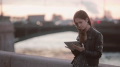 Beautiful young woman using tablet. Pretty lady standing at the quay, smiling Stock Footage