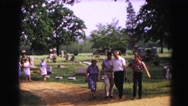 1962: a park scene is seen with beautiful flowers and grass area HAGERSTOWN Stock Footage