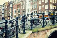 Amsterdam canal and bicycles Stock Photos