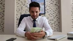 Money loving rich businessman in office Stock Footage