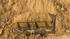 Dump truck being loaded with soil by shovel Stock Footage