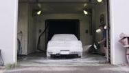Adult man washing his car Stock Footage