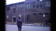 1962: a drive through a city street where a large building has been damaged Stock Footage