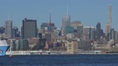 Cruise liner Norwegian breakaway cruising in Hudson River with Manhattan Stock Footage