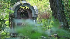 Old aged grave crypt in cemetery Stock Footage
