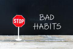 STOP BAD HABITS message written on chalkboard Stock Photos
