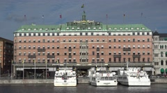 Sightseeing boat off Grand Hotel Stockholm Sweden Stock Footage