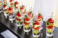 Appetizers with cherry tomatoes, olives, olive oil, cheese and spices in glasses Stock Photos