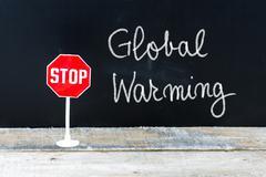 STOP GLOBAL WARMING message written on chalkboard Stock Photos