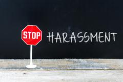 STOP HARASSMENT message written on chalkboard Stock Photos
