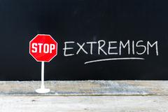 STOP EXTREMISM message written on chalkboard Stock Photos