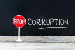 STOP CORRUPTION message written on chalkboard Stock Photos