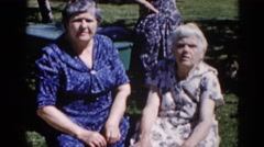 1962: two people talking to each other outside on the field CHICAGOLAND AREA Stock Footage