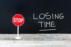 STOP LOSING TIME message written on chalkboard Stock Photos
