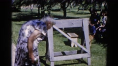 1962: picnic family outing reunion with grandmother walking CHICAGOLAND AREA Stock Footage