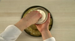 Cook dough laid in a form by cooking brush. Stock Footage