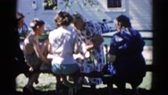 1962: women are seen in beautiful dresses CHICAGOLAND AREA Stock Footage