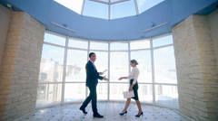 Business, real estate concept. Man and woman shaking hands at office Stock Footage