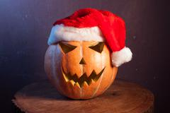 Jack-o ' - lantern in a red Santa hat Stock Photos