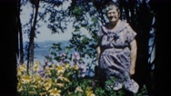 1962: grandma enjoys a beautiful spring day with a breeze near the shore. Stock Footage