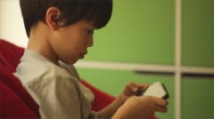 Child playing with smart phone Stock Footage