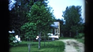 1962: a look of a neighborhood with their front yards and their cars parked out Stock Footage