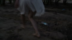 Frightened girl , young woman crawls, runs away from the killer in forest Stock Footage