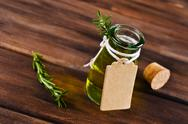 Oil with dry leaves of rosemary Stock Photos