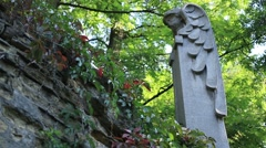 Sculpture of winged angel at the old cemetery Stock Footage