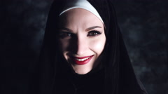4k Halloween Shot of a Horror Nun Smiling at Camera Stock Footage