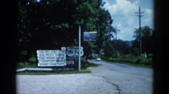 1962: a road is seen having flags along CHICAGOLAND AREA Stock Footage