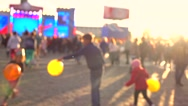 Defocused kids playing with air balloons on evening street. Warm colors. 4K Stock Footage