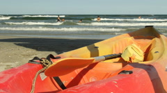 Red rescue boat, lifeboat on the beach of the blue sea. People swimming Stock Footage