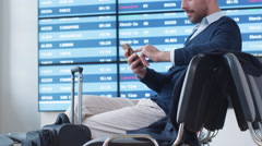 Man using Phone while Waiting Boarding at Departure Lounge at the Airport. Stock Footage
