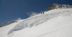 Two Mountaineers Crossing a Glacier. Stock Footage