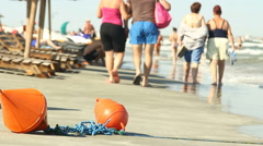 Happy people enjoy, swimming, walking, relax on the beach of the blue sea Stock Footage