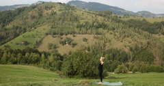 Beautiful Young Woman Practices Yoga Moves Positions Outdoors Mountain Clifftop Stock Footage