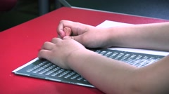 Little Girl Writing Braille  Stock Footage
