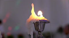 Inspiring the flame of the candle Stock Footage
