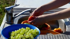 Hand Wash Cucumbers and Tomatoes Under Water Tap. Stock Footage