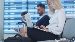 Attractive Adult Business Woman using Laptop while Waiting Boarding in Airport Stock Footage