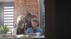 Group of young students working on project in modern loft apartment. Stock Footage