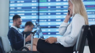 Attractive Adult Business Woman Talking on the Phone while Waiting Boarding Stock Footage