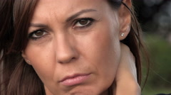 Sad woman with depressed gaze in a front extreme closeup portrait Stock Footage