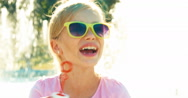 Close up portrait girl blowing soap bubbles near fountain and laughing Stock Footage